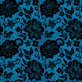 Black lace flower on blue Stock Photos
