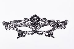 Black lace mask for masquerade. Black delicate lace mask isolated on a white background. Black carnival mask royalty free stock images