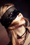Black lace over eyes. Blond woman portrait with black lace over eyes studio shot Stock Photos