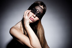 Black lace over face Royalty Free Stock Photo