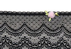 Black lace with satin flower Royalty Free Stock Image