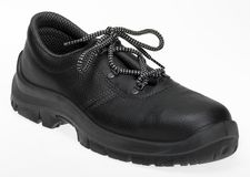 Black lace-up shoe. Made of leather in white back Royalty Free Stock Photography