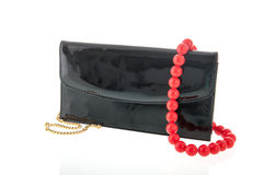 Black lack bag and red necklace Stock Photography