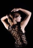 Black lacy jacket on naked spine Royalty Free Stock Photo