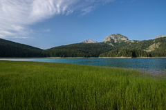 The black lake, Durmitor, Montenegro. Crno Jezero (Black Lake) is premium tourist attraction of Durmitor area. It is the biggest and the best known of 18 glacier Royalty Free Stock Photo