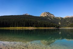 Black Lake - Mountain lake`Crno jezero` with Meded Peak and reflections in clear water stock photo