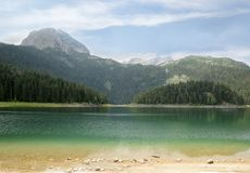 Black Lake. Durmitor National Park Montenegro. Black Lake. A small glacial lake that is located on the Mount Durmitor within the Durmitor National Park in the Stock Photos