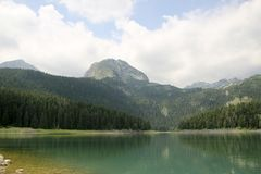 Black Lake. Durmitor National Park Montenegro. Black Lake. A small glacial lake that is located on the Mount Durmitor within the Durmitor National Park in the Stock Photography