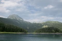Black Lake. Durmitor National Park Montenegro. Black Lake. A small glacial lake that is located on the Mount Durmitor within the Durmitor National Park in the Stock Image