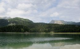 Black Lake. A beautiful glacial lake in  Durmitor National Park, Montenegro. Black Lake. A small glacial lake that is located on the Mount Durmitor within the Royalty Free Stock Images