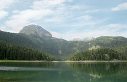 Black Lake. A beautiful glacial lake in  Durmitor National Park, Montenegro. Black Lake. A small glacial lake that is located on the Mount Durmitor within the Stock Image