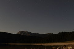 Black Lake with starts. Black Lake on Durmitor mountain at night with stars, National Park in Montenegro stock image