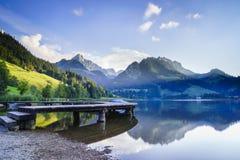 Black lake in Switzerland Stock Images