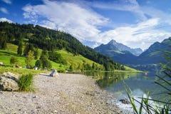 Black lake in Switzerland Stock Photography