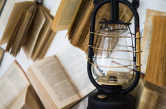 Black Lamp of old book on white background. Black Lamp closeup of old book on white background Royalty Free Stock Photo
