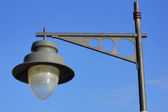 Black lamppost with blue sky. Simple composition with black lamppost and blue sky Royalty Free Stock Photos