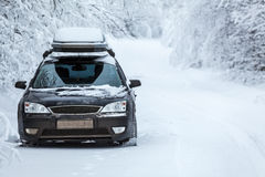 Black land vehicle standing on winter road Stock Image