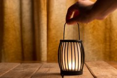 Black lantern with a candle. Close up Royalty Free Stock Photo