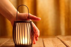 Black lantern with a candle. Close up Royalty Free Stock Image