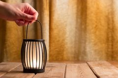 Black lantern with a candle. Close up Stock Photo