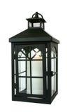 Black Lantern Over White. Black lantern with a burning candle inside Royalty Free Stock Image