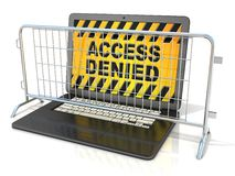 Black laptop with ACCESS DENIED sign on screen, and steel barricades Royalty Free Stock Image