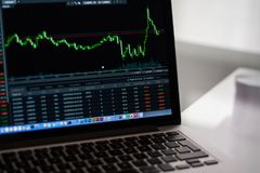 Black Laptop Computer Showing Stock Graph Royalty Free Stock Images