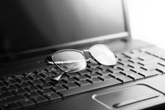 Laptop and glasses stock image