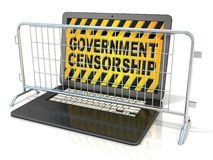 Black laptop with GOVERNMENT CENSORSHIP sign on screen, and steel barricades Royalty Free Stock Photos
