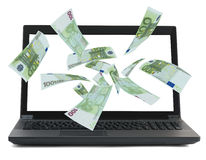 Black laptop with money euro flow. Black laptop with money flow on isolated white background royalty free stock image