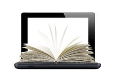 Black laptop and openned book isolated on white Royalty Free Stock Images