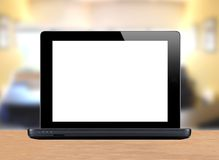 Black laptop over bright office Royalty Free Stock Images