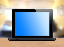 Black laptop over bright office Stock Photography
