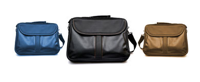Black laptop packing bags on white background Royalty Free Stock Images