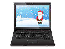 Black laptop with santa Stock Image