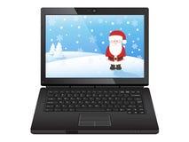 Black laptop with santa stock image