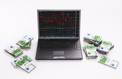 Black Laptop and stacks of euros 3d Royalty Free Stock Photos