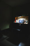 Black Laptop in Study Table Near Lamp Stock Photos