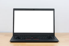 Black laptop on wooden table Royalty Free Stock Image