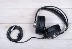 Black large headphones for music and computer games with microphone and usb cable on white background royalty free stock photography