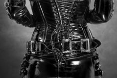 Black latex corset. Black shiny latex corset with some buckles and ropes royalty free stock photos