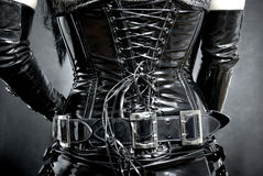 Black latex corset. Woman in black latex corset, back royalty free stock images