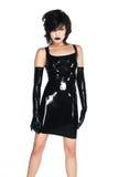 Black latex. Tall slender woman dressed in black latex stock images