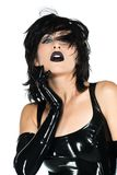 Black latex. Tall slender woman dressed in black latex royalty free stock photography