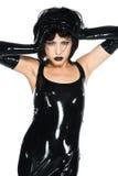 Black latex. Tall slender woman dressed in black latex stock photo