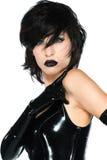 Black latex. Tall slender woman dressed in black latex stock photos