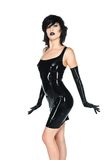 Black latex. Tall slender woman dressed in black latex royalty free stock photo