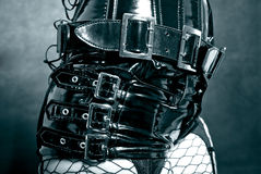 Black latex uniform with metal buckles. Woman in black latex uniform - corset with metal buckles stock images