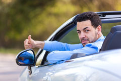 Black latin american driver making thumbs up Royalty Free Stock Photography