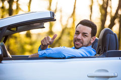 Black latin american driver making thumbs up Royalty Free Stock Photo